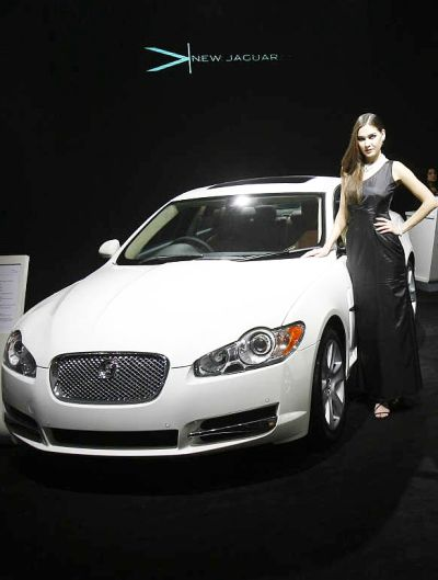 A model poses with a Jaguar XF in New Delhi.