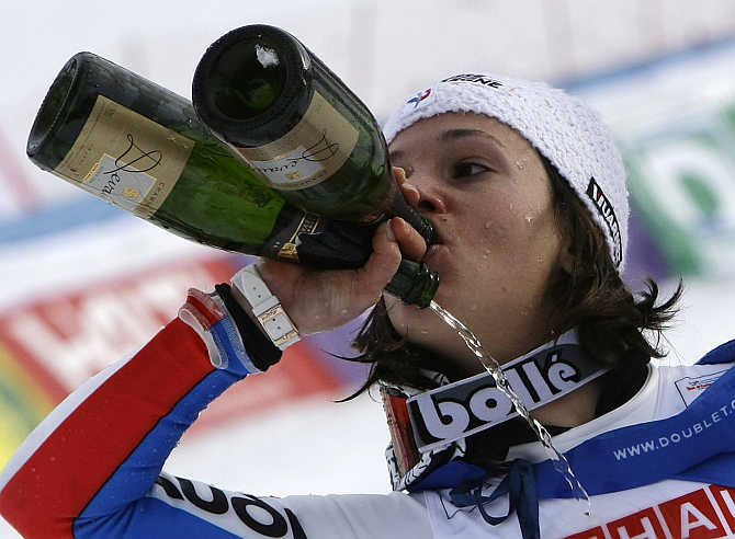 Marie Marchand-Arvier tries to drink at once from two different bottles of champagne after winning the silver medal during the women's Super G race at the Alpine Skiing World Championships in the French resort of Val d'Isere.