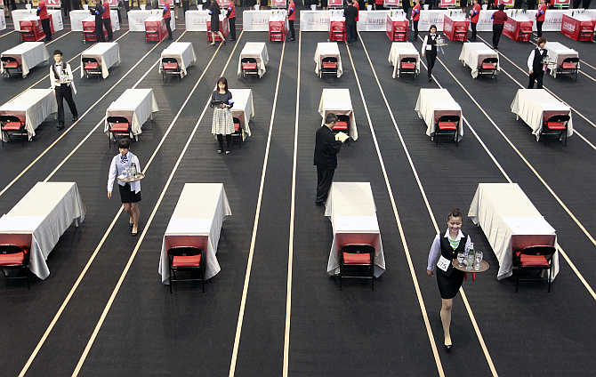 Contestants race with trays holding beer bottles and glasses during a tray carrying competition in Taipei, Taiwan.