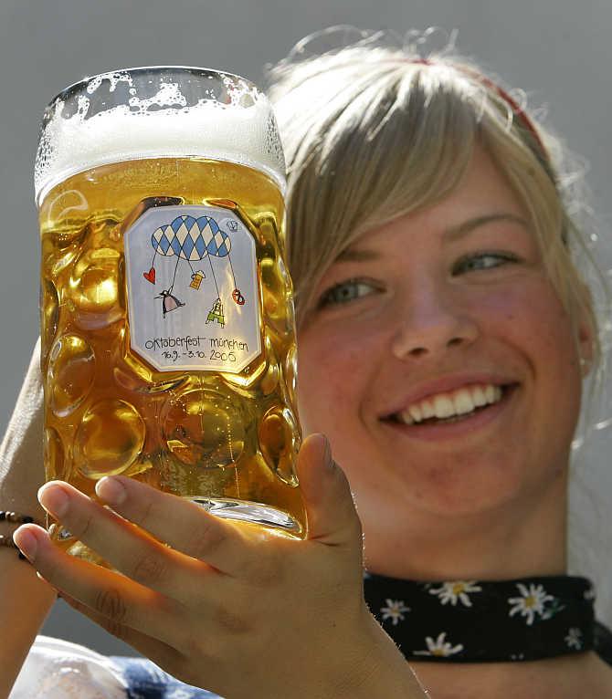 Leonie Stoehr presents the Oktoberfest beer mug in Munich, Germany.
