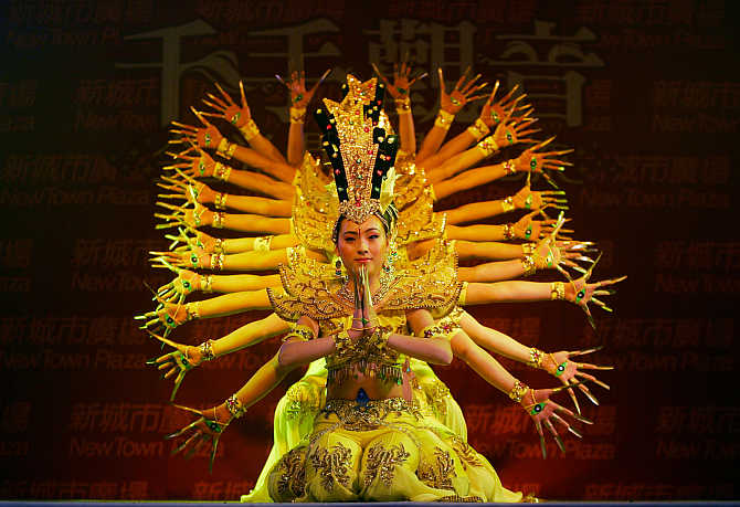 Chinese dancers perform at a shopping mall in Hong Kong.