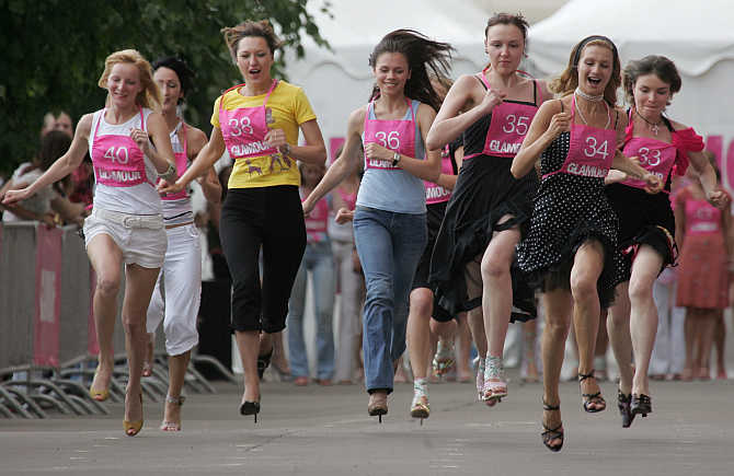 Women compete in a high-heel sprint in Moscow, Russia.