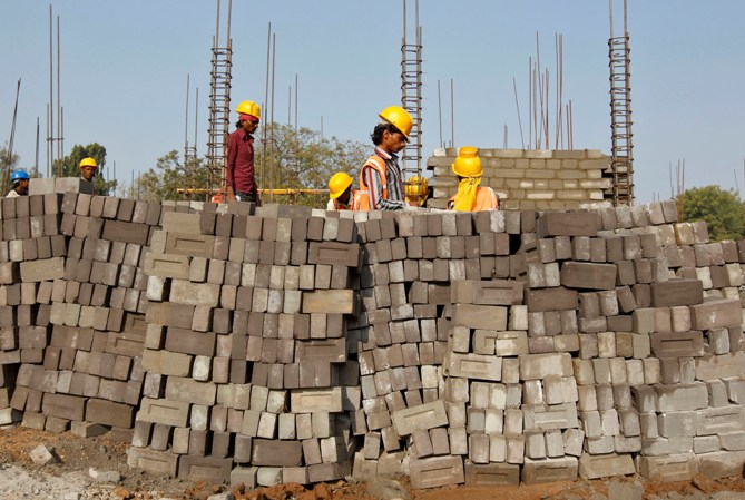 Labourers work at the construction site of an educational institute in Gujarat.