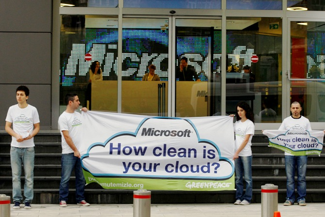 Greenpeace activists hold a banner during a demonstration against what they say are energy choices made by Microsoft.
