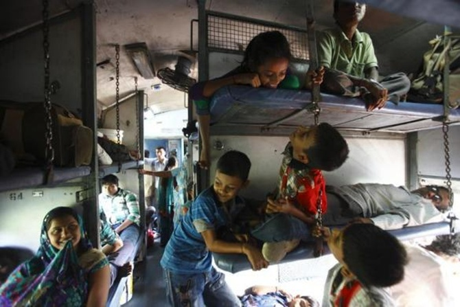 Children travel on a train heading from Agra to Kanpur in Uttar Pradesh.