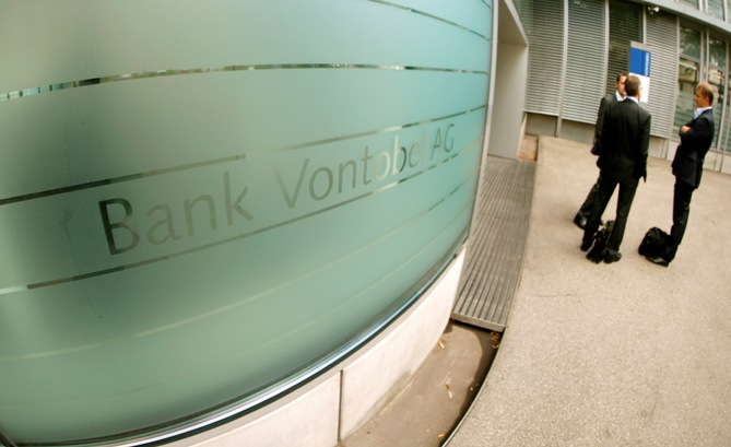 Men stand in front of the headquarters of Swiss bank Vontobel in Zurich.