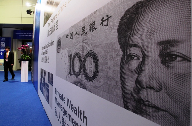 An enlarged printout of a Renminbi banknote is displayed at the Asian Financial Forum in Hong Kong January 14, 2013.