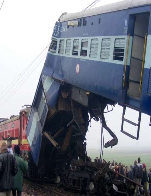Wreckage of a train is seen at the site of an accident in Etawah, Uttar Pradesh.