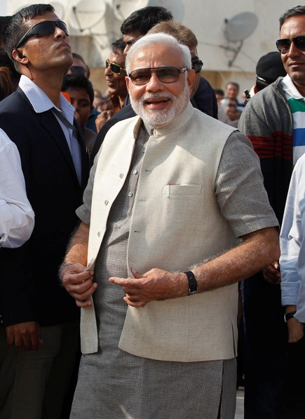 Narendra Modi, prime ministerial candidate for Bharatiya Janata Party and Gujarat's chief minister, smiles during a kite flying festival in Ahmedabad January 14, 2014.