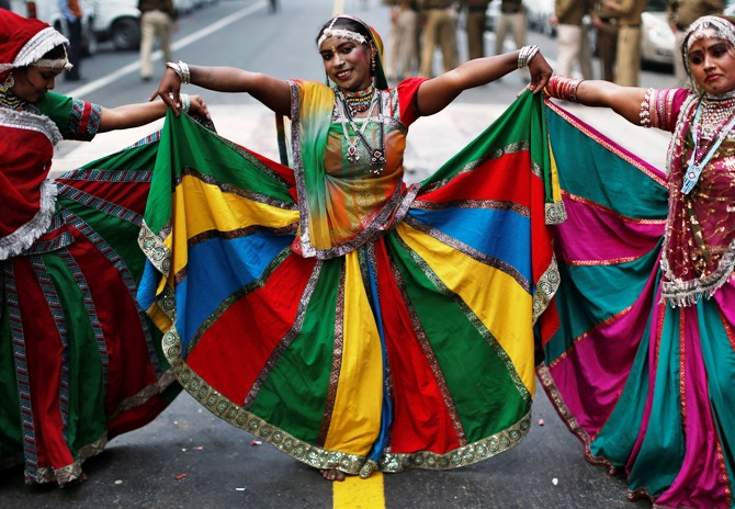 Dancers perform during celebrations outside the headquarters of Bharatiya Janata Party in New Delhi December 8, 2013.