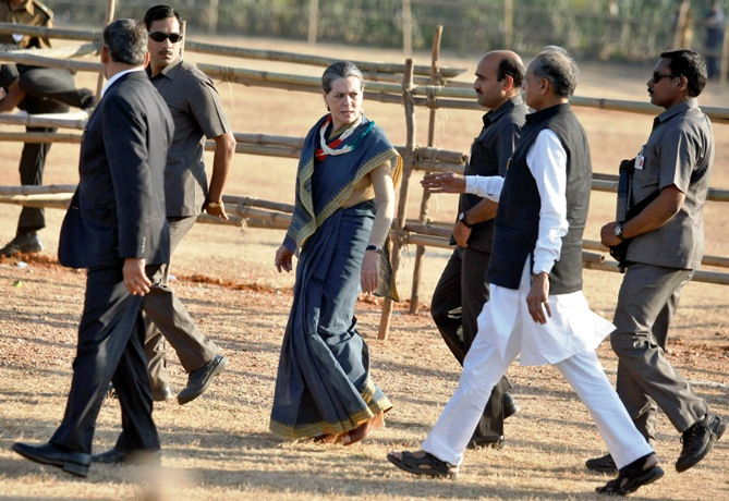 Chief of Congress party Sonia Gandhi walks to greet her supporters after she addressed a rally.
