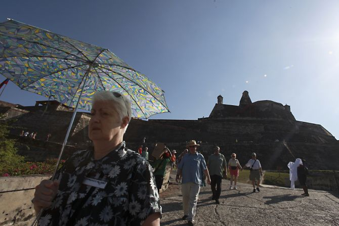 Tourists visit at the Castillo San Felipe in Cartagena, December 16, 2012. Cartagena's peak season for tourism starts on December 15 and goes on into the second week of February.