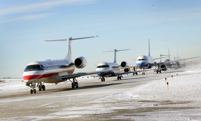 Planes wait in line to take off from O'Hare International Airport.