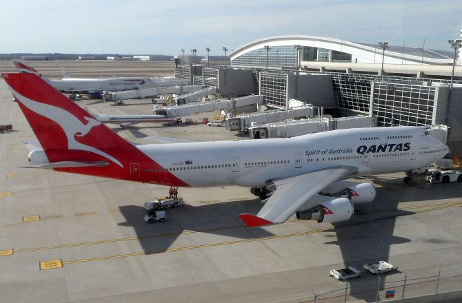 The Boeing 747-400ER operated by Qantas parked at Terminal D of Dallas/Fort Worth International Airport.