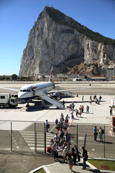 Passengers disembark a flight shortly after landing at Gibraltar International Airport.