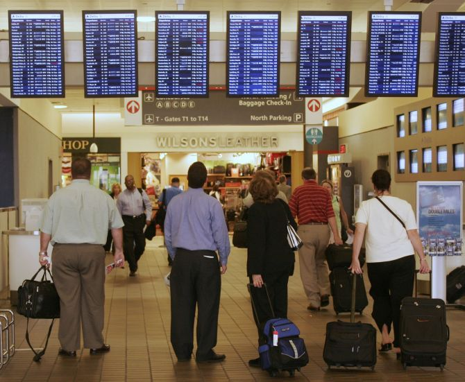 Travellers pause to check flight information before proceeding to their gates at Hartsfield-Jackson Atlanta International Airport.
