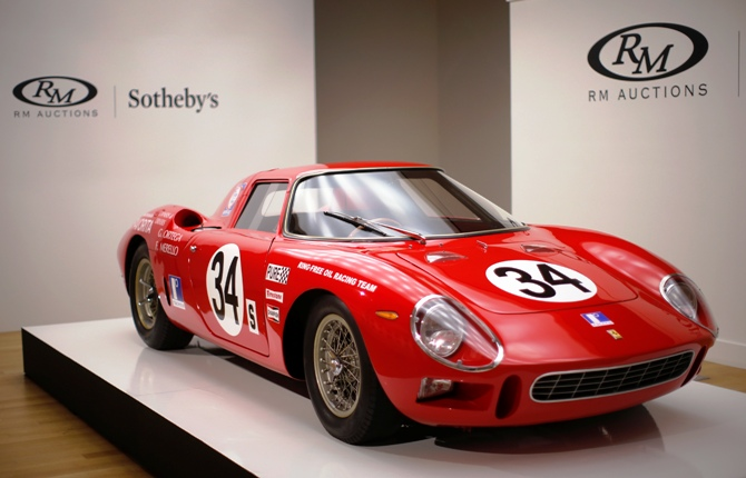 A 1964 Ferrari 250 LM (estimated $12-$15 million) is on display during a media preview of the 'Art of Automobile' auction at Sotheby's auction house in New York, November 18, 2013.