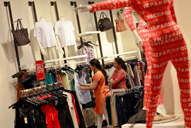 People shop for clothes during a seasonal sale at a store inside a shopping mall in Mumbai.