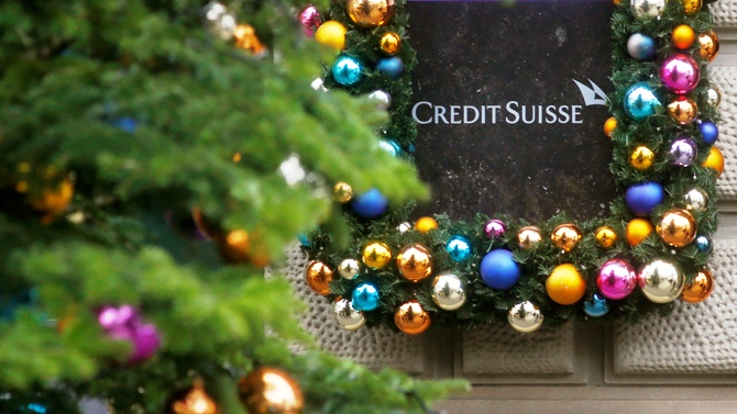 Christmas decoration is placed around the logo of Swiss bank Credit Suisse beside the entrance to its headquarters in Zurich.