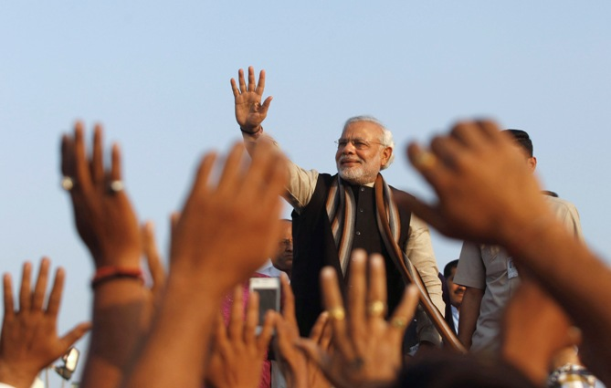 Narendra Modi, prime ministerial candidate for Bharatiya Janata Party and Gujarat's chief minister, waves towards his supporters.