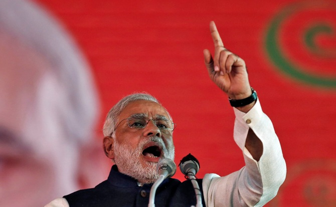 Narendra Modi, prime ministerial candidate for Bharatiya Janata Party and Gujarat Chief Minister, speaks during BJP's national council meeting at Ramlila ground in New Delhi January 19, 2014.