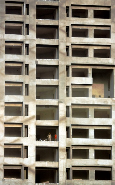 Workers stand in a building under construction in Mumbai.