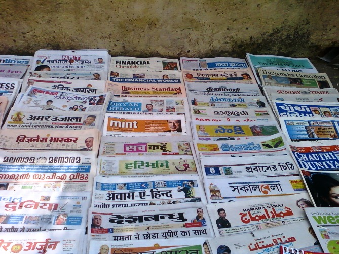 Indian Newspapers for sale at a vendors shop in New Delhi.