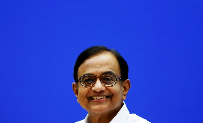 India's Finance Minister Palaniappan Chidambaram smiles during a news conference in New Delhi.