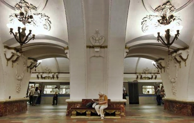 A woman sits on a bench at Prospekt Mira metro station in Moscow.
