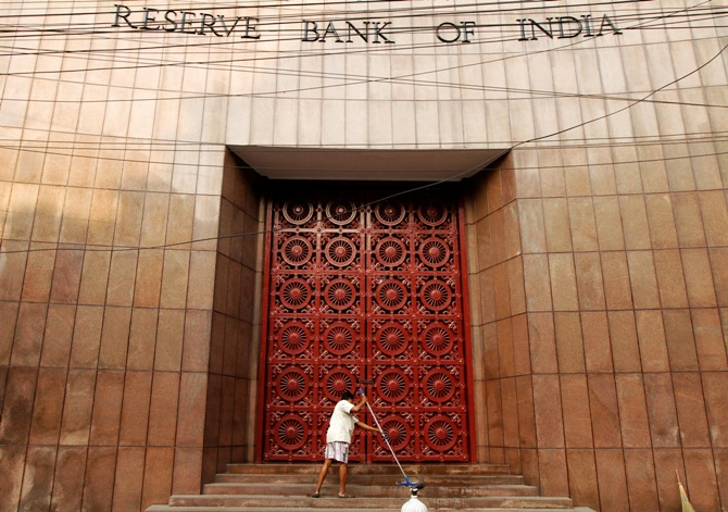 A worker cleans the stairs of the Reserve Bank of India building in Kolkata.