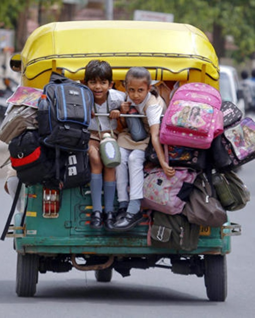 School children pack a auto-rickshaw on their way to school in Ahmedabad.