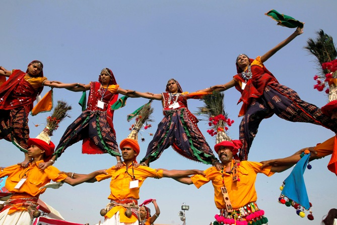 Folk dancers wearing traditional attire perform at the international kite festival in Ahmedabad.