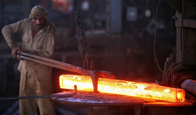 A labourer works inside an iron factory on the outskirts of Jammu.