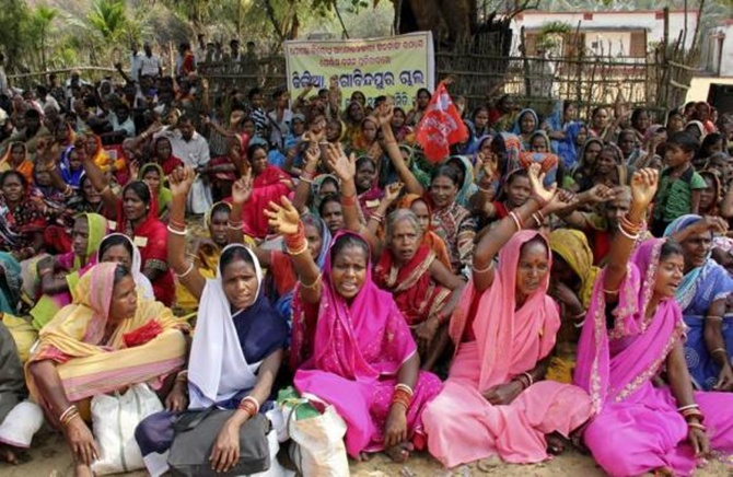 Demonstrators shout slogans during a protest against land acquisition at Gobindpur village in Jagatsinghpur district in Odisha.