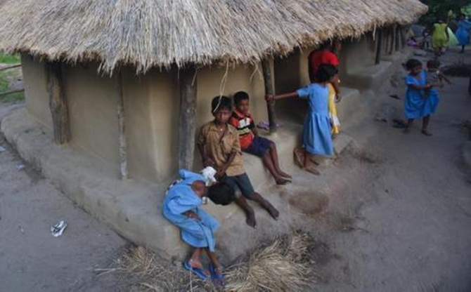 Children gather at the entrance of their thatched hut in Gobindpur village, about 75 km east of Orissa's capital Bhubaneswar . Gobindpur is one of several villages from which people will have to be relocated for the plant.