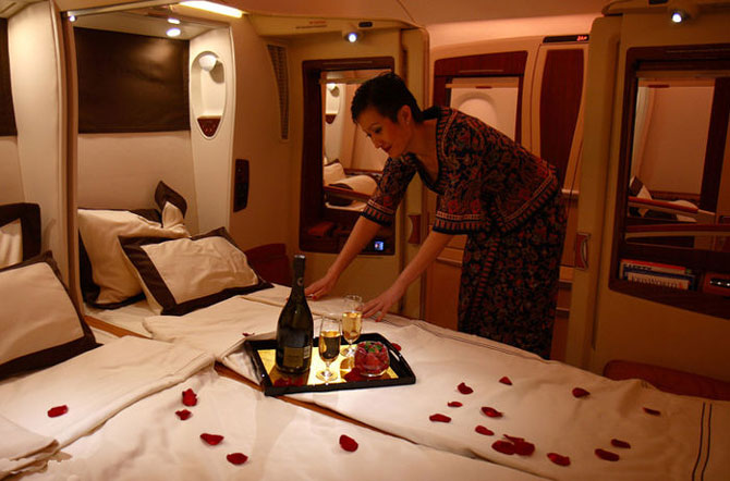 A crew member of Singapore Airlines A380 is preparing the cabin for passengers to experience ultimate comfort.