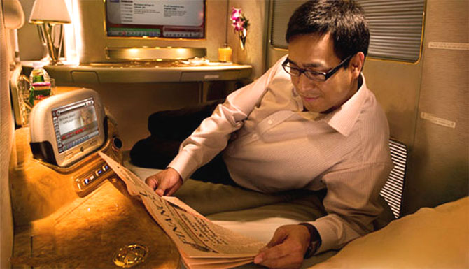 A passenger enjoying the comfort of Emirates A380 cabin.
