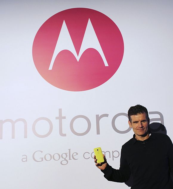 Motorola Mobility Chief Executive Dennis Woodside poses with the new Moto G mobile phone during its worldwide presentation in Sao Paulo.