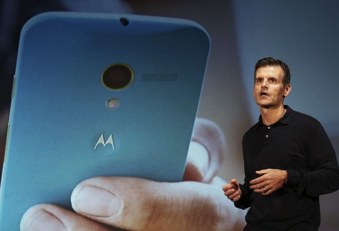Motorola Mobility Chief Executive Dennis Woodside talks during the worldwide presentation of the Moto G mobile phone in Sao Paulo.