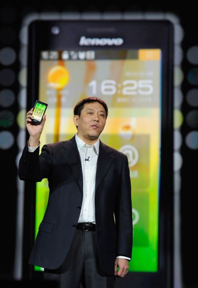 Senior vice president and president of Lenovo's Consumer Business Group Liu Jun shows the new Lenovo smartphone.