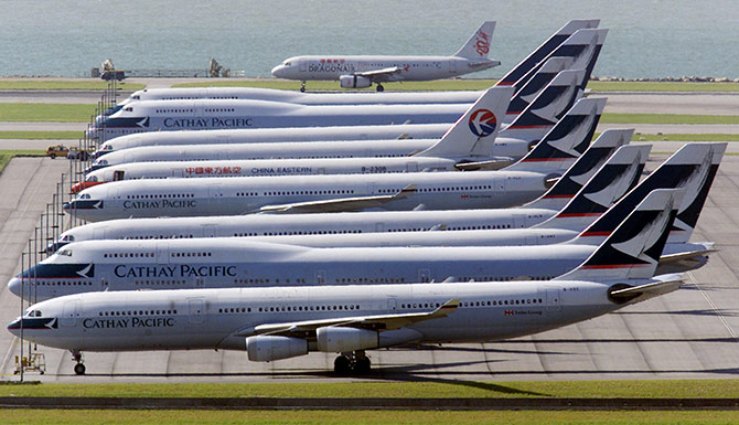 A column of Cathay Pacific Airways planes at the Hong Kong international airport.