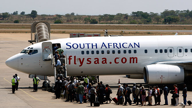 Passengers board a South African Airways Boeing 737 aircraft at the Kamuzu International Airport in Lilongwe.