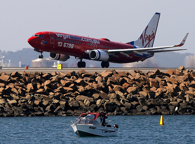 A Virgin plane takes off from Kingsford Smith airport in Sydney.