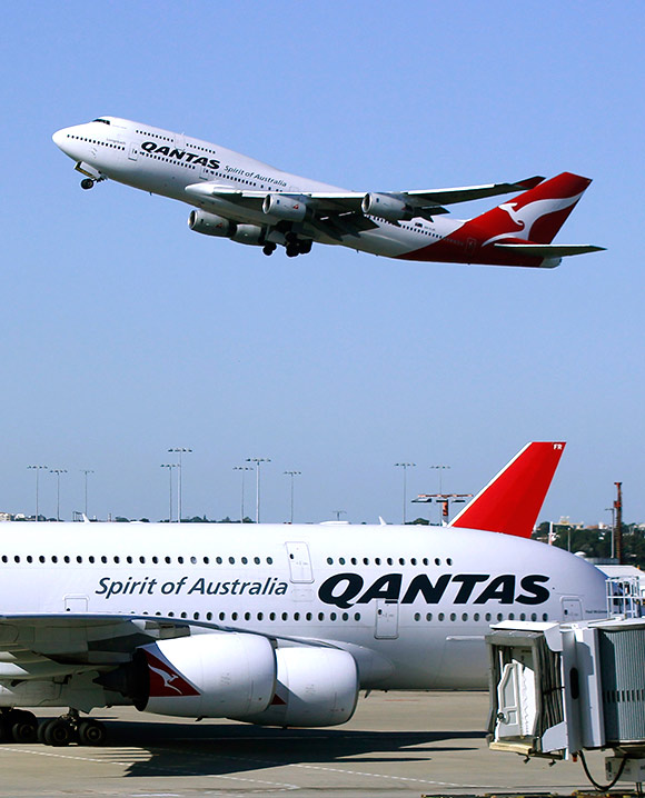 A Qantas 747 flies past a Qantas A380 as it takes off from Kingsford Smith international airport in Sydney.