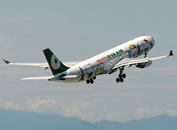An Airbus A330-300 aircraft of Taiwan's Eva Airlines, decorated with Hello Kitty motifs, takes off from Taoyuan International Airport, northern Taiwan to Sapporo, Japan.