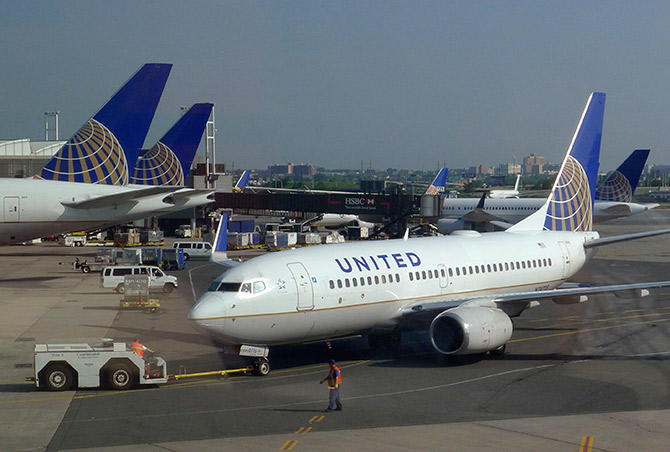 A United Airlines airplane is towed to a gate after arriving at Newark Liberty International Airport in Newark.