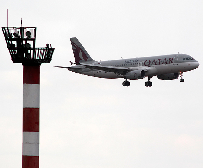 A Qatar Airwais Airbus A320 plane prepares to land at Henri Coanda Airport in Otopeni, near Bucharest.