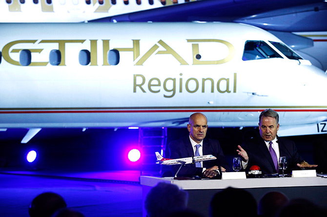 James Hogan, CEO of Etihad Airways sits beside Maurizio Merlo (L), CEO of Darwin Airline as he addresses a news conference to launch Etihad Regional airline at the airport in Zurich.