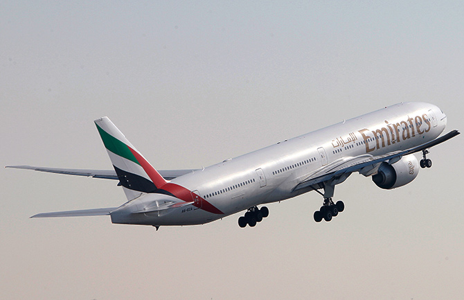 An Emirates Airlines Boeing 777-300 aircraft takes off during the Dubai Airshow.
