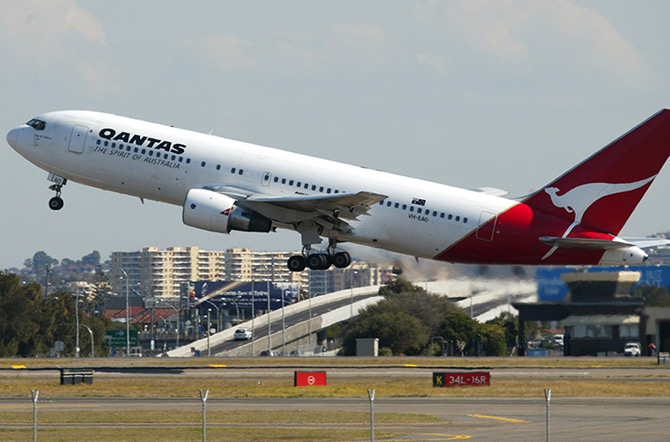 A Qantas passenger jet takes off from Sydney Airport.